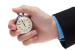 holding stop watch