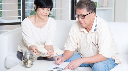 Asian-retiree-couple-elderly-finances-calculator-money.jpg
